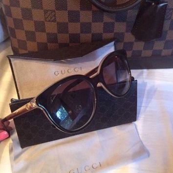 ONETOW womens gucci gold and black sunglasses
