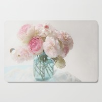 pink roses in blue jar Cutting Board by sylviacookphotography