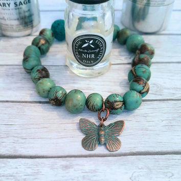 Essential oil, bracelet, diffuser jewelry, butterfly, lava beads, aromatherapy jewelry, acai seed, boho jewelry, hippy jewelry, gift for her