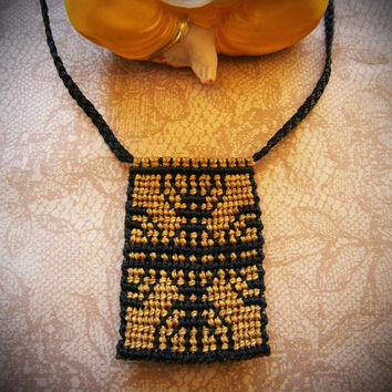 Macramé necklace precolumbian style and native symbol.mapuche symbol.