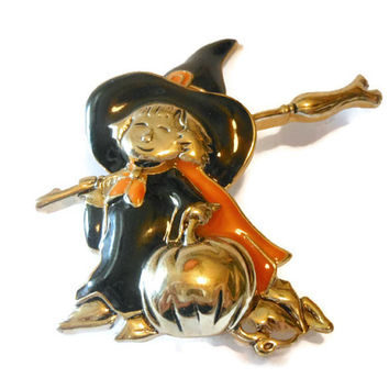 Adorable Monet child in witch costume with with broomstick and pumpkin in original box