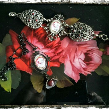 Handmade victorian-style black and red cabochon pendant