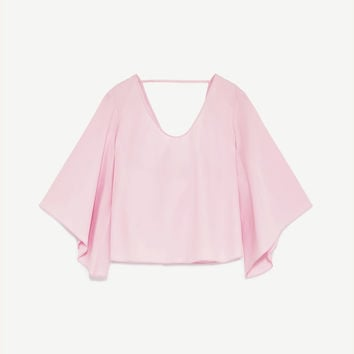 BLOUSE WITH FLARED SLEEVES DETAILS