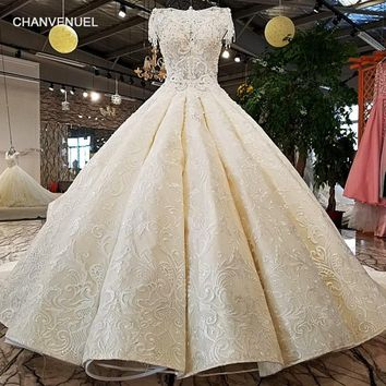 LS98170 O-neck 2018 luxury new arrival lace cap sleeve lace appliques beaded princess wedding dress with long train from china