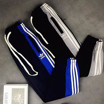 Adidas clover Logo embroidered pair of matching color pantaloons for summer sports and leisure wear leg guards long pants