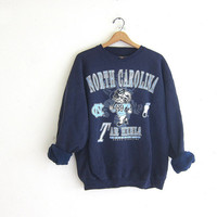 vintage North Carolina sweatshirt. Tar Heels sports sweatshirt. blue college sweater