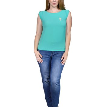 Plus size top featuring a boxy silhouette, round neckline, w/brooch detail and back button closure