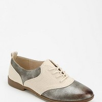 Restricted Saddle Oxford