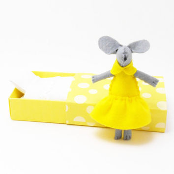 Neon yellow stuffed felt mouse in a matchbox