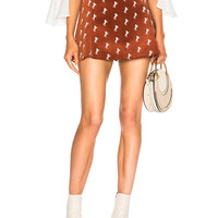 Chloe Horse Embroidered Mini Skirt in Crimson Brown | FWRD