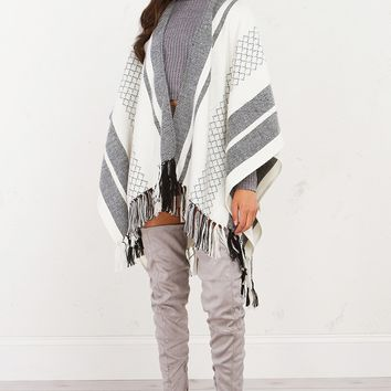 AKIRA Black Label Patterned Knit Poncho With Fringe Tassel Detail in Ivory/Black