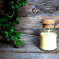 Milky white soy wax candle in the bottle with scent of linden