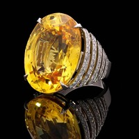 An Exceptional Yellow Sapphire And Diamond Ring By Hancocks London
