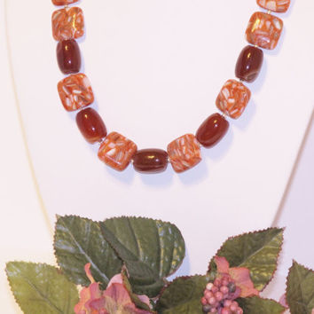 Make a Bold Statement with this Red-Orange Mother of Pearl Resin Beads and Carnelian Necklace