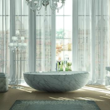 Asymmetric freestanding oval bathtub I bordi Collection by TEUCO GUZZINI