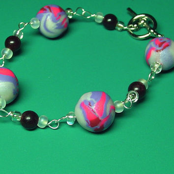 Beaded bracelet. silver wire wrapped bracelet. polymer clay bracelet pink and purple red and white. christmas in july