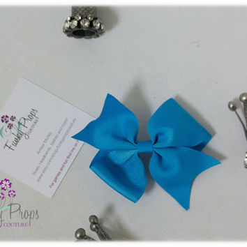 3.5 inch blue bow.  Christmas. Stocking Stuffers. Back to school.  Birthday girl. Ready to ship.