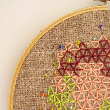 Beaded hand embroidery wall art, geometric triangles green, peach and burgundy on rustic fabric