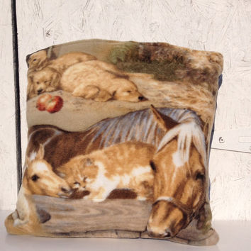 Fleece Quillow with baby farm animals, a quilt that folds into a decorative pillow