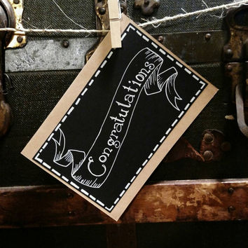 Black and white handmade congratulations greeting card.