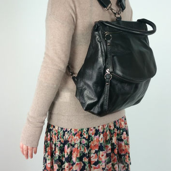 Leraje Convertible Backpack | Shoulder bag - black, made of  rich shrunken leather. wear it as a backpack or shoulder bag
