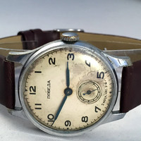 "RARE Vintage men's watch called ""VICTORY""( Pobeda),this Soviet wristwatch comes with high quality new leather band!"