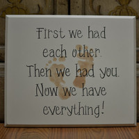 "Baby Sign, ""First we had each other, then we had you, now we have everything"". With tan, pink or blue baby feet."