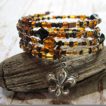 Memory wire bracelet with black, gold and browns with Fleur de Lis, New Orleans Saints inspired bracelet, wrap bracelet
