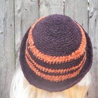 Brown and reddish orange chenille crochet beanie with a twist