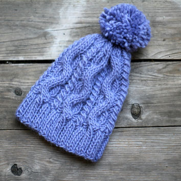 Knit cabled hat for women in violet lavender color with pompom