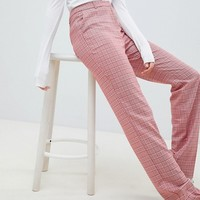 ASOS DESIGN Tailored Slim Flare Trousers in Red Check at asos.com