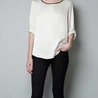 BLOUSE WITH CONTRASTING EDGING - Woman - New this week - ZARA United States