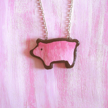 Pig necklace silhouette light pink made entirely by hand in cold porcelain and painted by hand