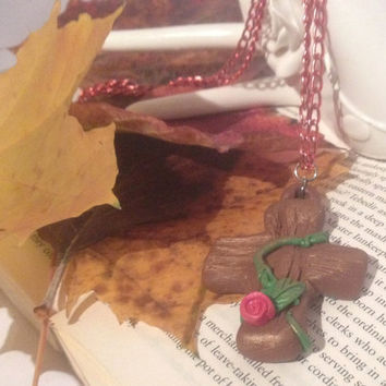 Polymer Clay Cross and Rose Pendant on a Red Aluminium Chain.