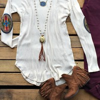Our All About You Tunic Top is perfect for colder weather! It's a long sleeve waffle knit top with seam detail on the back and embroidery elbow patch. Very comfortable!