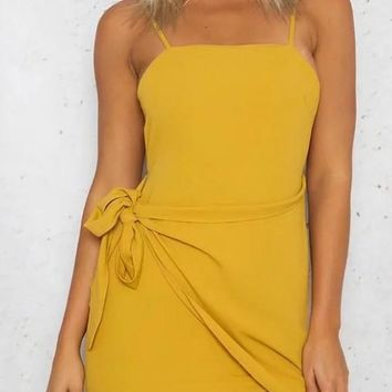 Yellow Irregular Bow Tie Back Open Back Mini Dress