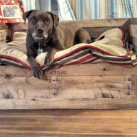 Dog bed made of used shipping pallets.