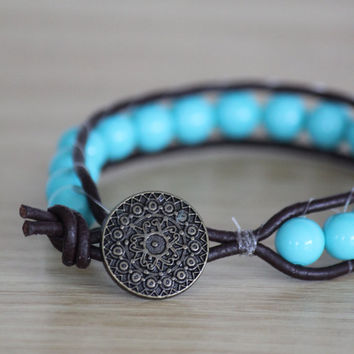 Boho beaded leather wrap bracelet with big turquoise beads and a beautiful button