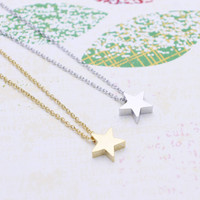 Tiny Star  necklace in  silver or gold tone