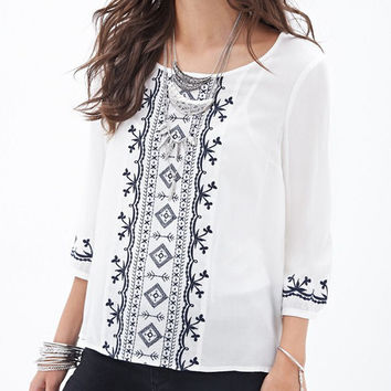 White Round Neck Embroidered Dip Hem Blouse