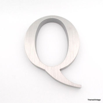 Industrial salvaged aluminum letter Q