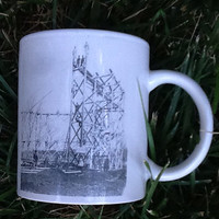 Vintage coffee cup commemorating the building of the Riverview Park wooden roller coaster in Des Moines, Iowa in 1915