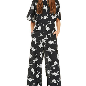 DailyLook: Line & Dot Blossom Jumpsuit in Black / White XS - S