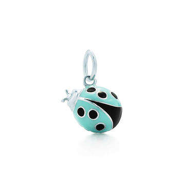 Tiffany & Co. - Ladybug charm in sterling silver with blue and black enamel finish, small.