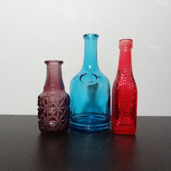 Vintage Set of Three Rustic Small Colored Glass Old Bottles - Red, Amethyst, and Blue
