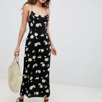 ASOS DESIGN Cami maxi dress in daisy print at asos.com