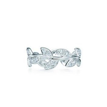 Tiffany & Co. -  Paloma Picasso® Olive Leaf narrow band ring in 18k white gold with diamonds.