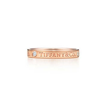 Tiffany & Co. -  Tiffany & Co.® band ring in 18k rose gold with diamonds, 3 mm wide.