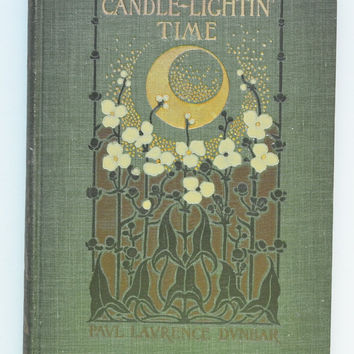 Candle-Lightin' Time by Paul Laurence Dunbar. Illustrated with photographs by the Hampton Institute Camera Club and Decorations by Margaret Armstrong.