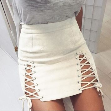 Fashionable new suede skirt with sexy buttock strap